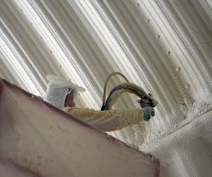 Applying Polyurethane Foam Insulation to the inside of an agricultural home